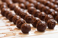 Chocolate truffles drying on baking parchment