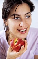 Young woman holding a nectarine