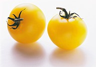Two yellow tomatoes