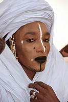 In-Gall, near Agadez, Niger, West Africa - Wodaabe Male, Dressed for the ´Male Beauty Contest,´ in which the whiteness of the eyes and the teeth is an...