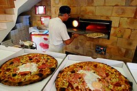 A pizza shop near Pezenas France with a traditional wood fired over,