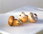 Mushrooms on a white chopping board