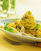 Tagliatelle with herbs, pine nuts and Parmesan shavings