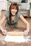Germany, Cologne, Woman rolling dough