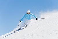 Italy, Trentino_Alto Adige, Alto Adige, Bolzano, Seiser Alm, Young woman skiing