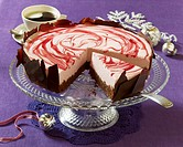 A Christmas chocolate cake with cranberry cream