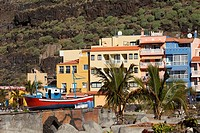 Spain, Canary Islands, La Palma, View of buildings with palm trees