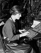 LINOTYPE OPERATOR, c1920s.Motion-picture still.