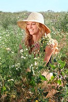 Blond girl on the summer meadow