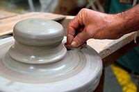 man potter hands working on pottery clay wheel stoneware sponge