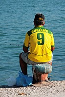 Fisherman with Brazilian soccer shirt