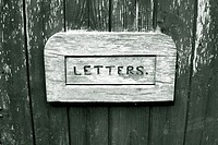 Letter box on old door close up