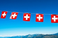 Swiss Flags and mountains in background