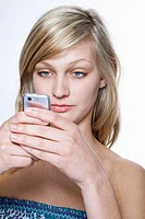 Blond Woman Texting on Mobile Phone