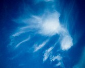 Wispy cloud in a blue sky