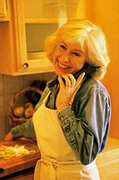 Senior woman talking on a telephone smiling