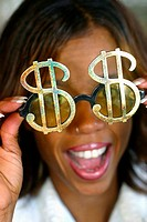 Woman holding dollar sign sunglasses