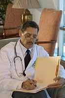 Male doctor reading a file
