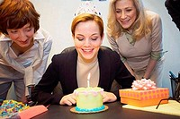 Close_up of a businesswoman celebrating her birthday with her colleagues