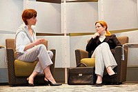 Two businesswomen sitting in an office