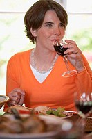 Close_up of a mid adult woman drinking red wine