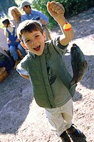 Portrait of a boy holding a fish on a fishing line