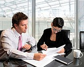 Businessman and businesswoman working together in an office