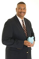 African American businessman with piggy bank