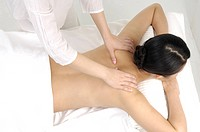 High angle view of a woman getting back massage
