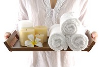 Woman holding spa products in a tray (thumbnail)