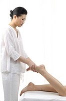 Close-up of a woman getting leg massage (thumbnail)
