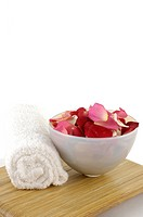Towel near rose petals