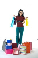 Woman with gifts and shopping bags