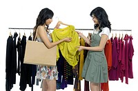Women choosing clothes in a clothing store
