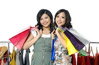 Women carrying shopping bags and smiling (thumbnail)
