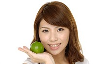 Young woman with green lime