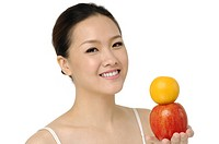 Portrait of beautiful asian female portrait with representation of fruits