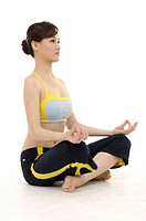 Beauty woman sitting in the Lotus position