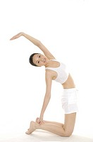 Woman who stretches oneself by stretch