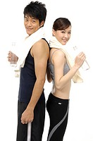 Man and woman relaxing after exercise