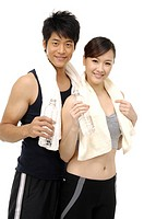 Woman and Man smiling and holding water bottles