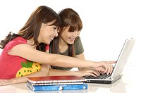 Two female university students using a laptop