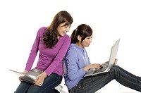 Two female university students working on laptops