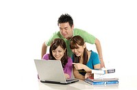 University students studying together with a laptop