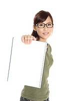 Female university student showing a spiral notebook