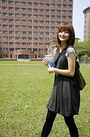 Female university student walking in a campus