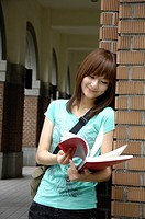 Female university student reading a book