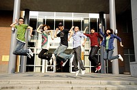 University students jumping together
