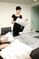 Architects discussing blueprints in a conference room (thumbnail)