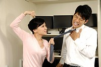 Businesswoman punching her colleague